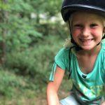 De magie en voordelen van paardrijden voor mijn paardenmeisje